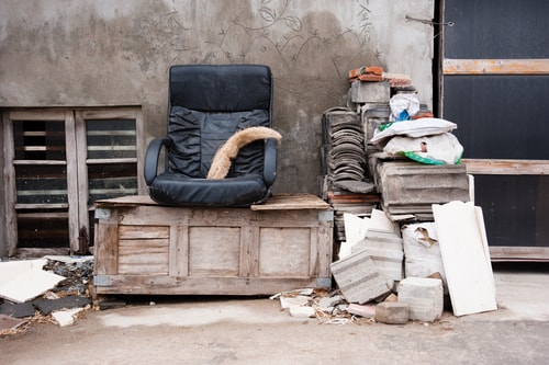 a pile of trash and furniture