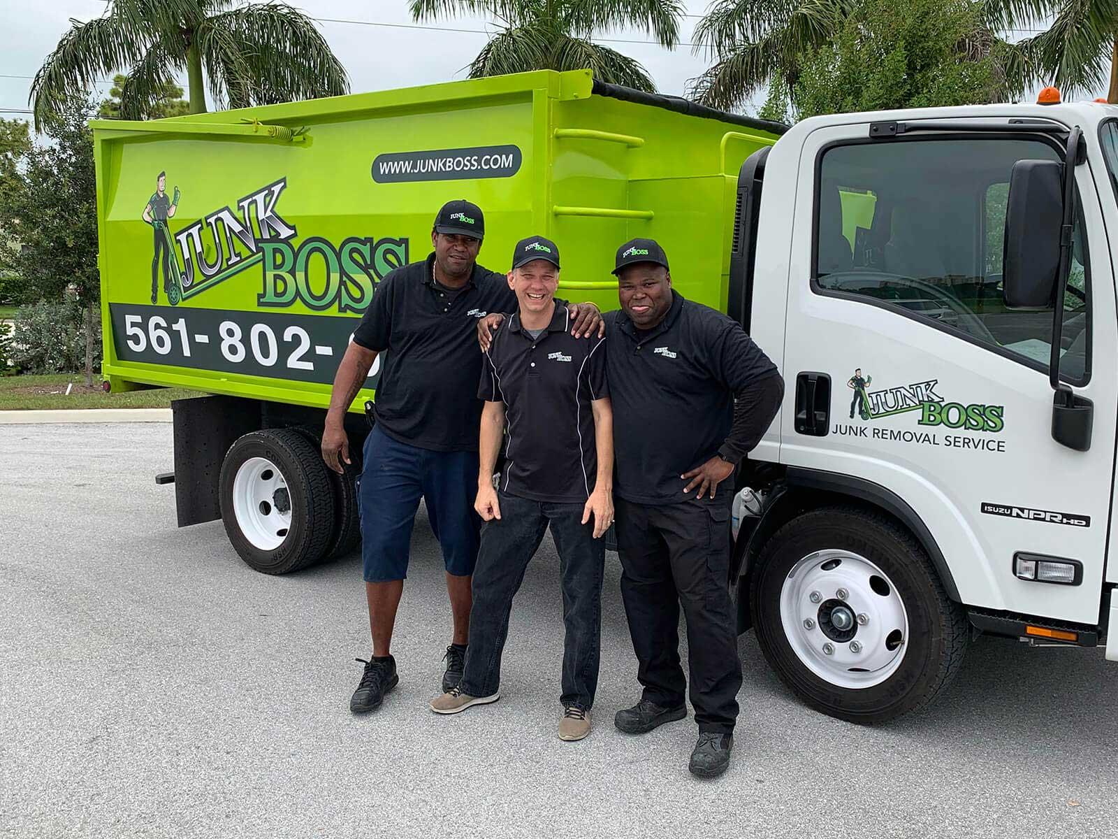 Junk Boss team beside the truck